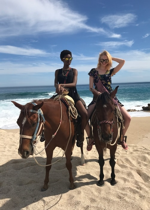 Amilna Estevão (Left) and Katie Moore as seen on horse-backs by the beach in April 2018