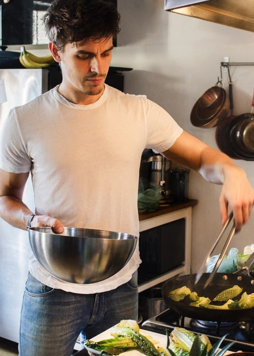 Antoni Porowski while preparing a meal in July 2018