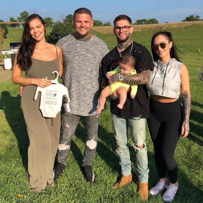 Cody Garbrandt holding his baby in a picture with his family in August 2018