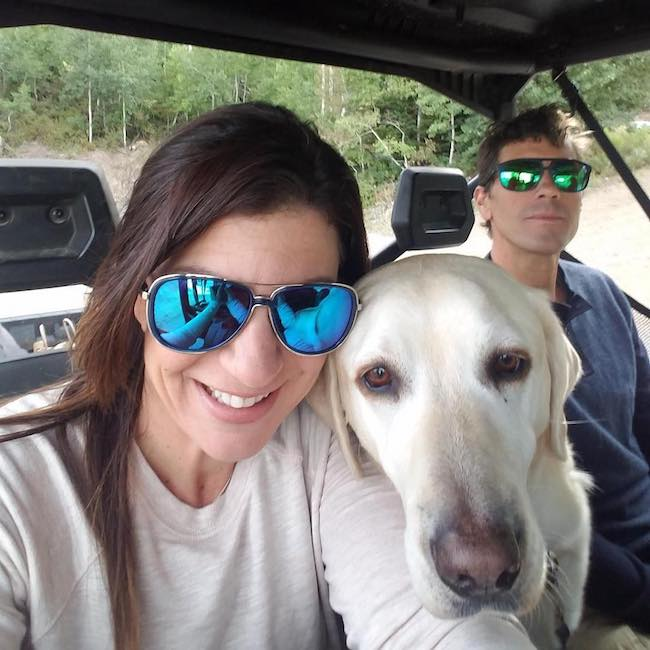 Danelle Umstead with her dog and husband in August 2018