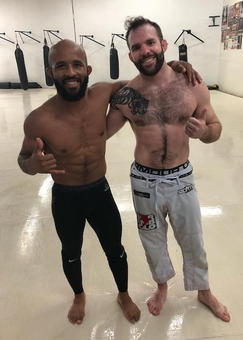 Demetrious Johnson with fellow MMA artist Jordan Galaugher (Right) in June 2018