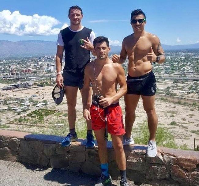 Dominick Cruz with Orlando Jimenez (Right) and Brendan Loughnane (Left) in Tucson, Arizona in September 2018