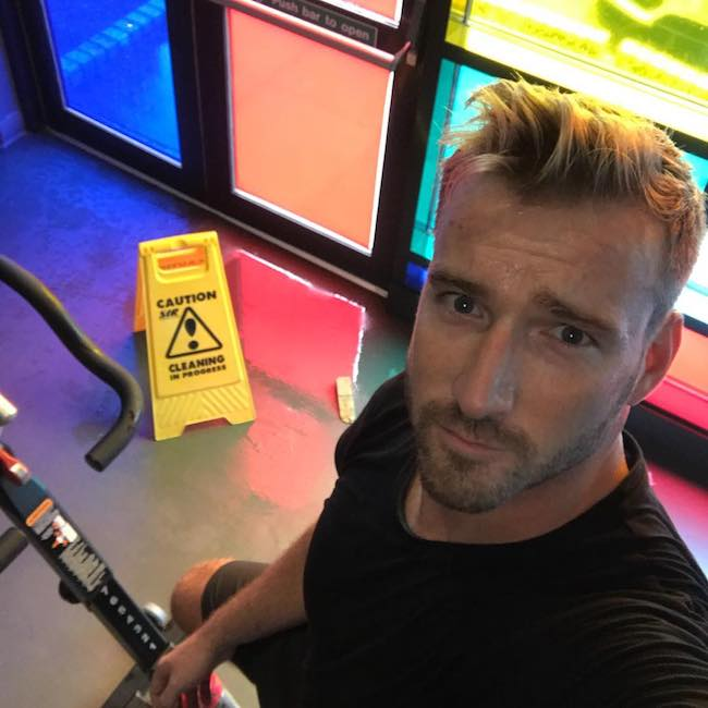 Jai McDowall doing spinning workout at TA Fitness in August 2018