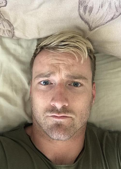 Jai McDowall lying down after his workout session at TA Fitness in June 2018