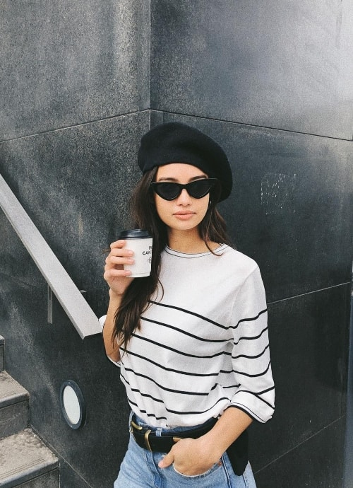 Kelsey Merritt enjoying her coffee in London, United Kingdom in February 2018