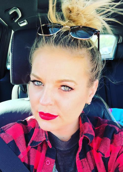 Kirsten Storms wearing red lipstick in a car selfie in February 2018