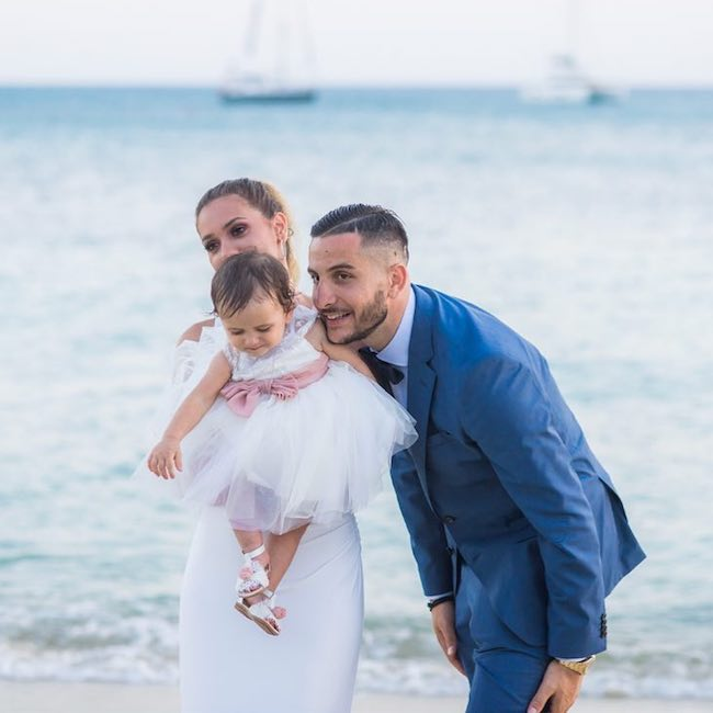 Kostas Manolas with Niki Prevezanou and their daughter in July 2018
