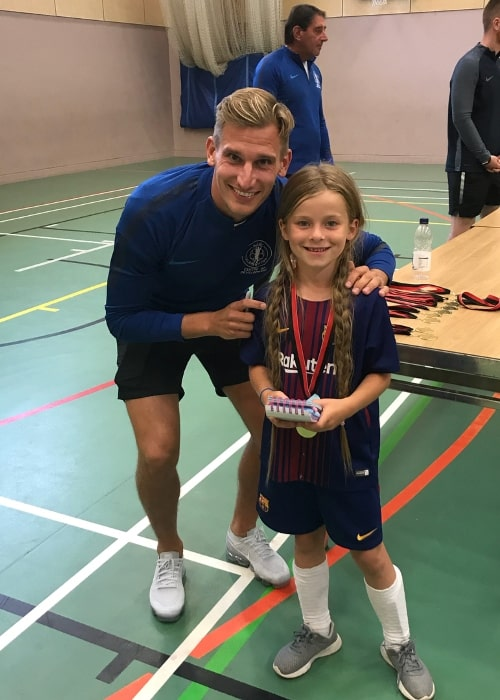Marc Albrighton signing an autograph for a young fan