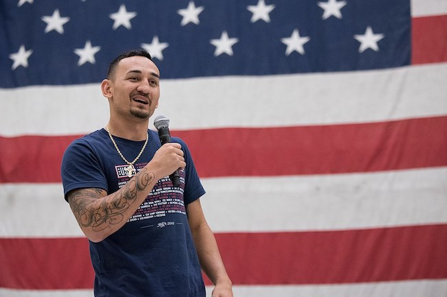 Max Blessed Holloway answers questions during a show for troops at Bagram Air Field in Afghanistan in April 2018