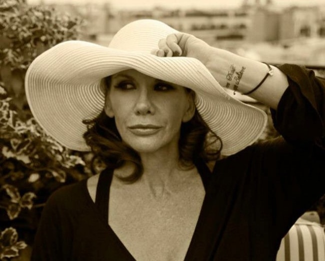 Melissa Gilbert in a picture wearing a white hat in Paris