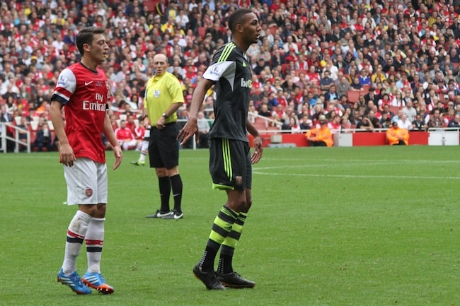 Mesut Özil and Steven N'Zonzi while standing on the football ground during AFC vs Stoke match in September 2013