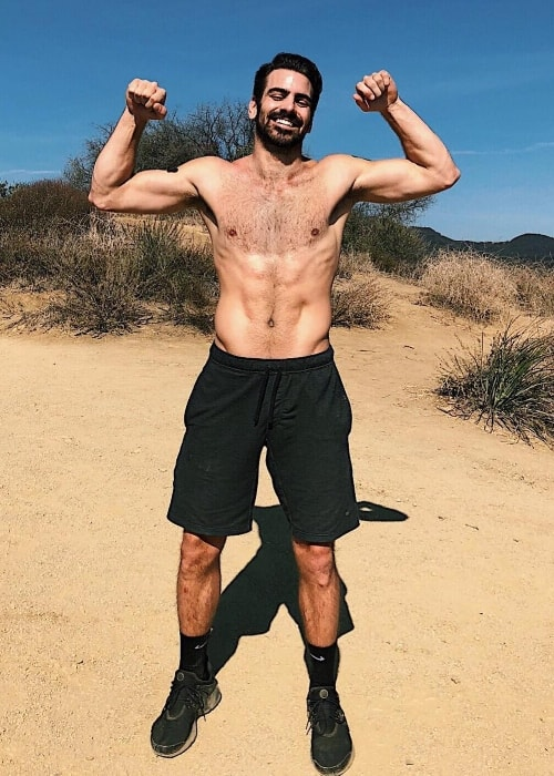 Nyle DiMarco showing his toned physique in Malibu, California in February 2018