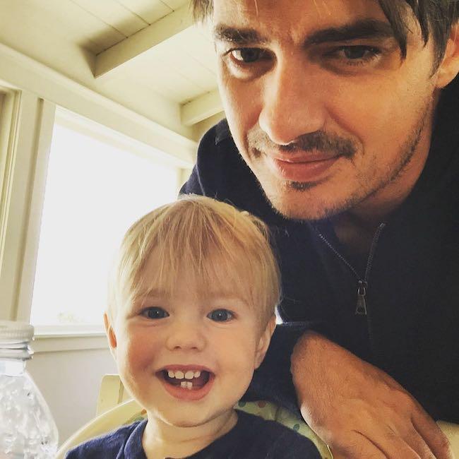 Sam Farrar with his son in August 2015