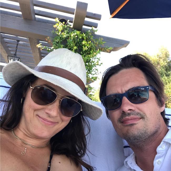 Sam Farrar with wife Stephanie Eitel on their 10th anniversary in July 2017