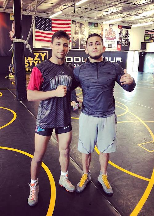 Sergio Pettis with Real Woods at Izzy Style School of Wrestling in August 2018