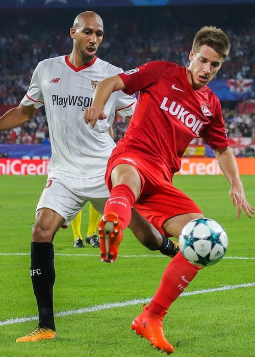 Steven N'Zonzi and Mario Pašalić while competing during a football match in 2017