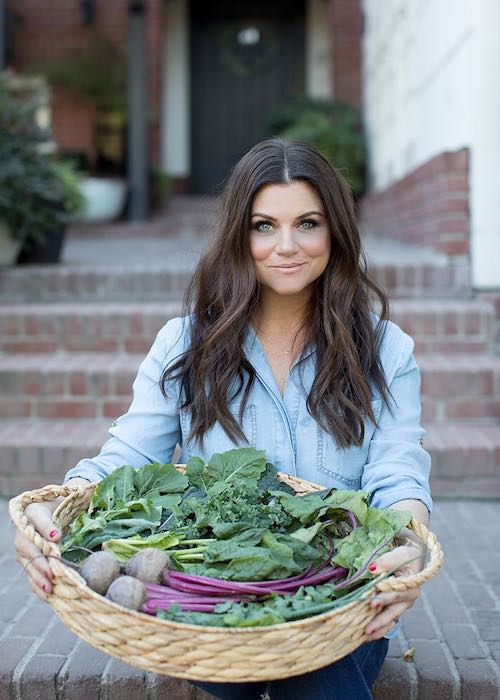 Tiffani Thiessen showing her home grown vegetables in her garden in January 2018