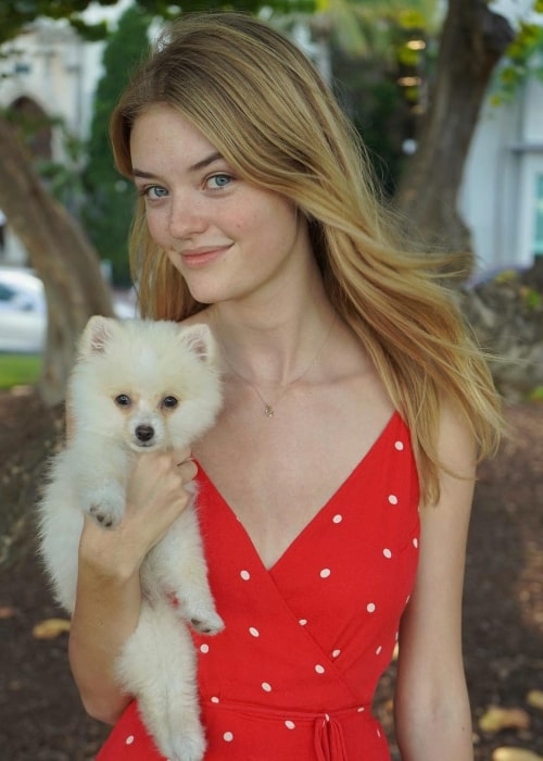 Willow Hand with her dog in Miami Beach, Florida in August 2018