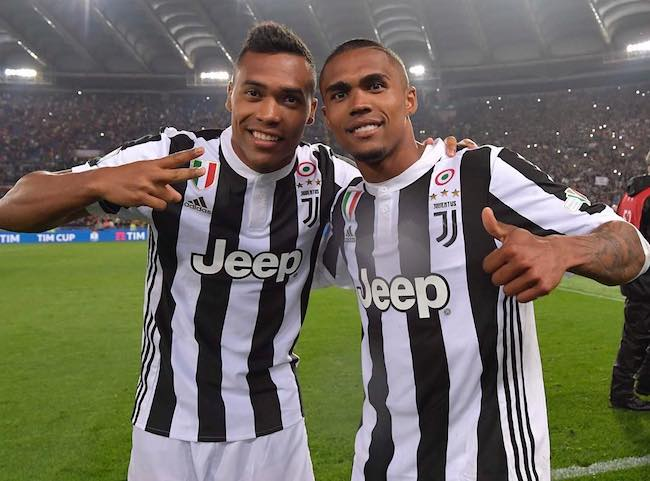 Alex Sandro (Left) with Douglas Costa as seen in September 2018