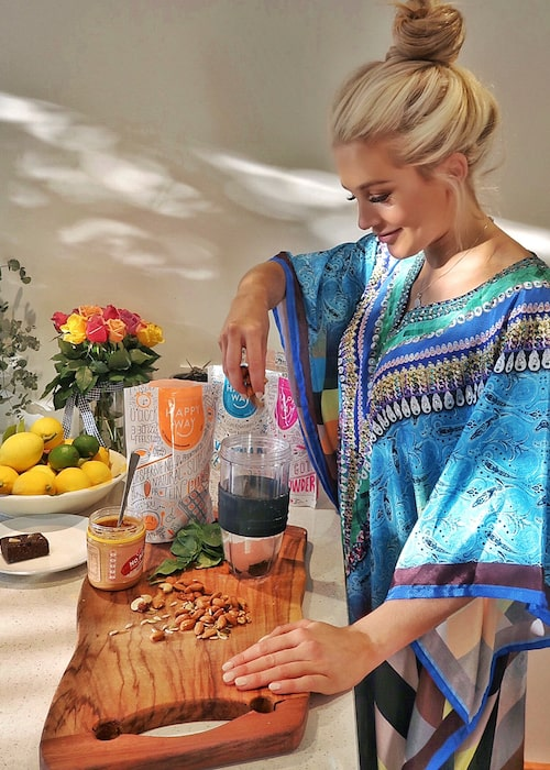 Ali Oetjen preparing a healthy and tasty meal using Happy Way supplements in June 2018