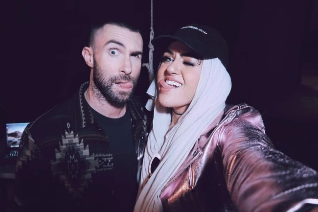 Amani Al-Khatahtbeh with Adam Levine in October 2018
