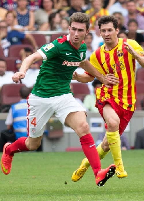 Aymeric Laporte (Left) with Lionel Messi during a La Liga match between FC Barcelona and Athletic Bilbao in September 2014