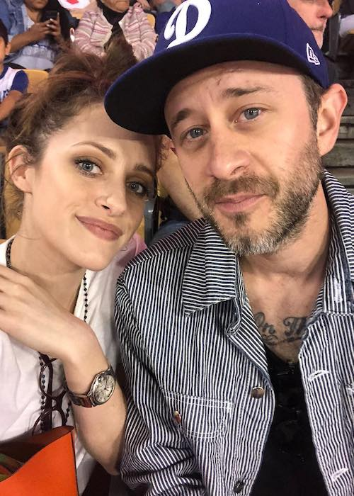 Carly Chaikin with Ryan Bunnell during a Los Angeles Dodgers match in April 2018