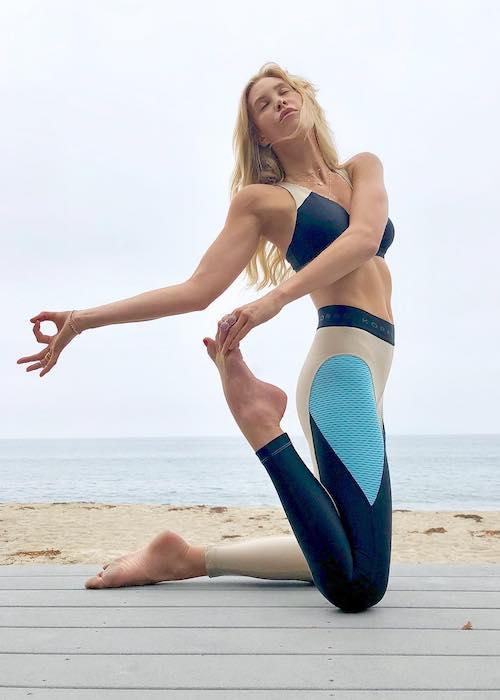 Claire Grieve doing yoga on the Malibu beach in October 2018