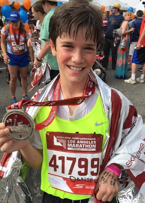 Daniel DiMaggio posing with his medal after running 26.2 miles in the Los Angeles Marathon in February 2016