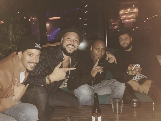 Dave Chappelle (Second Right) enjoying his time in October in 2018