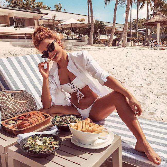 Ellie Gonsalves at Hamilton Island enjoying weather and food in August 2018