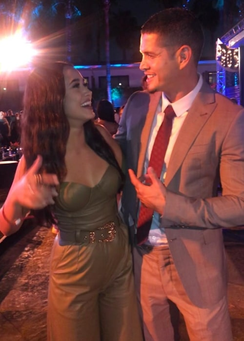 Emily Tosta sharing a laugh with JD Pardo in September 2018