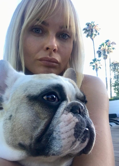Izabella Scorupco with her dog as seen in July 2018