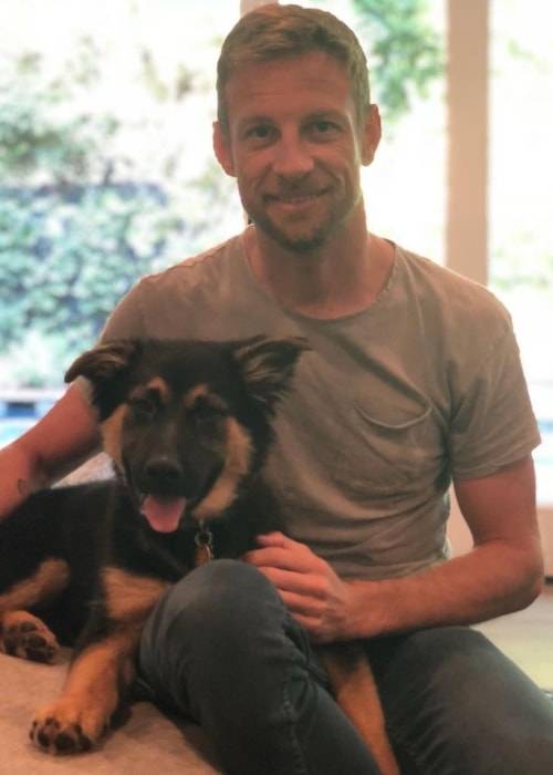 Jenson Button posing with his dog before leaving for Japan in April 2018