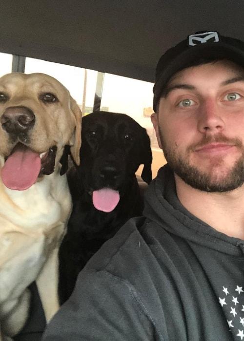 Tyler Eifert in a selfie with his dogs in December 2017
