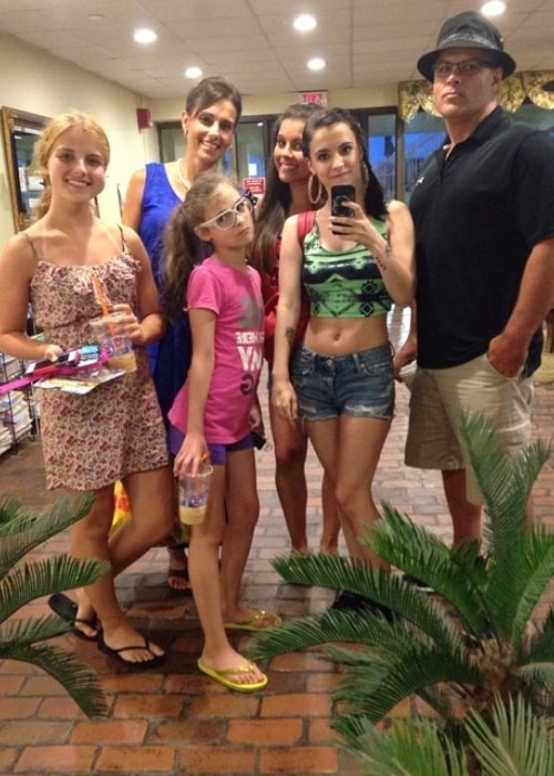 Alyssa Shouse taking a selfie with her family in July 2014