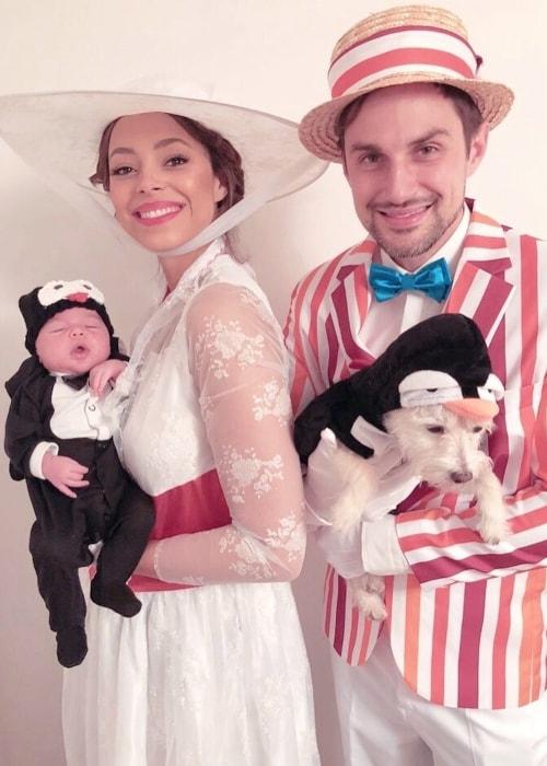 Amber Stevens West posing with her family in November 2018