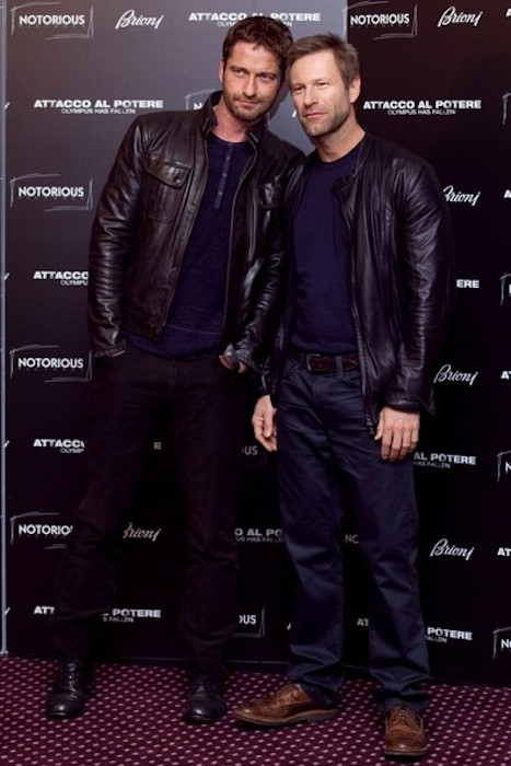 "Gerard Butler (Left) and Aaron Eckhart during the photocall for their film ""Olympus Has Fallen"" in 2013"