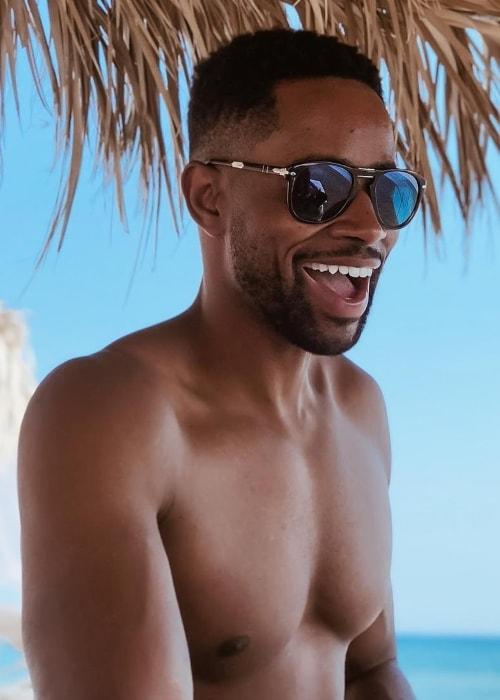Jay Ellis shirtless in Santorini Greece in July 2018