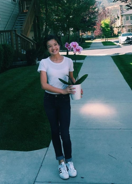 Peyton Elizabeth Lee posing with a plant in Park City, Utah in September 2016