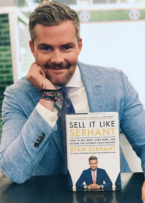 Ryan Serhant posing with his book in September 2018