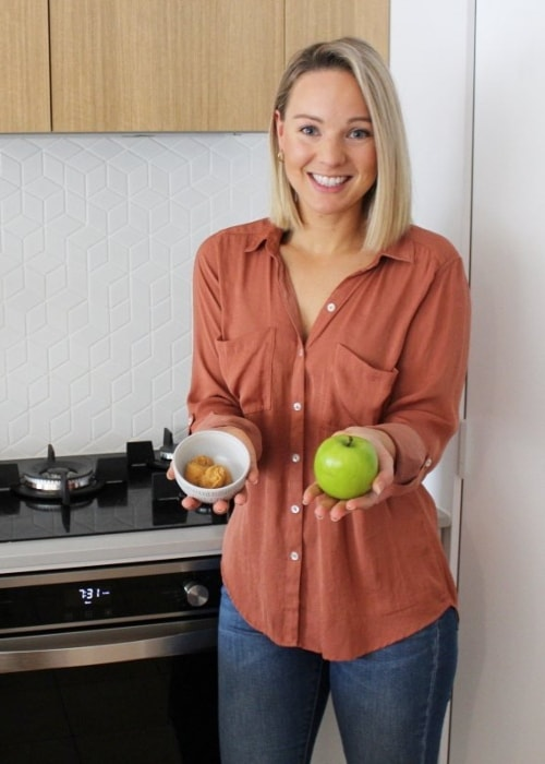 Steph Wearne posing with a granny smith apple and miso paste