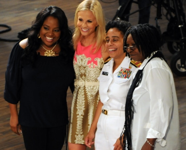 Whoopi Goldberg (Right) posing for a picture with U.S. Navy Rear Adm. Michelle Howard, alongside Sherri Shepherd (Left) and Elizabeth Hasselbeck (Second from Left) in May 2010