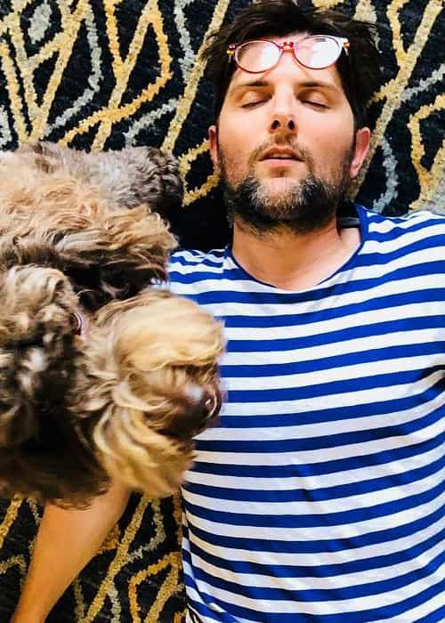 Adam Scott with his dog as seen in August 2018