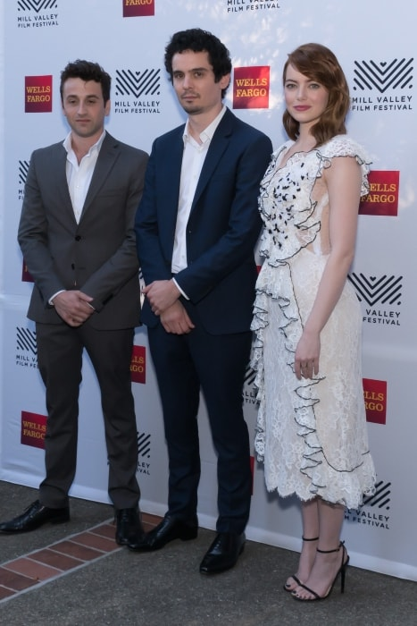 Damien Chazelle (Center) with Emma Stone and Justin Hurwitz at the 39th Mill Valley Film Festival in October 2016