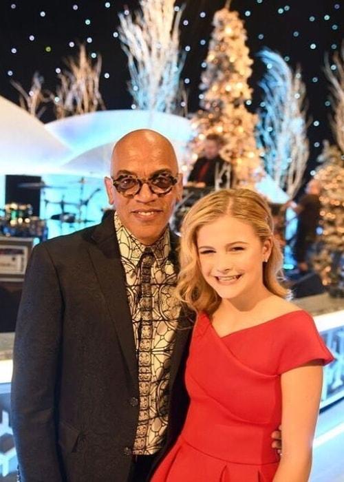 Darci Lynne Farmer with Rickey Minor in December 2018