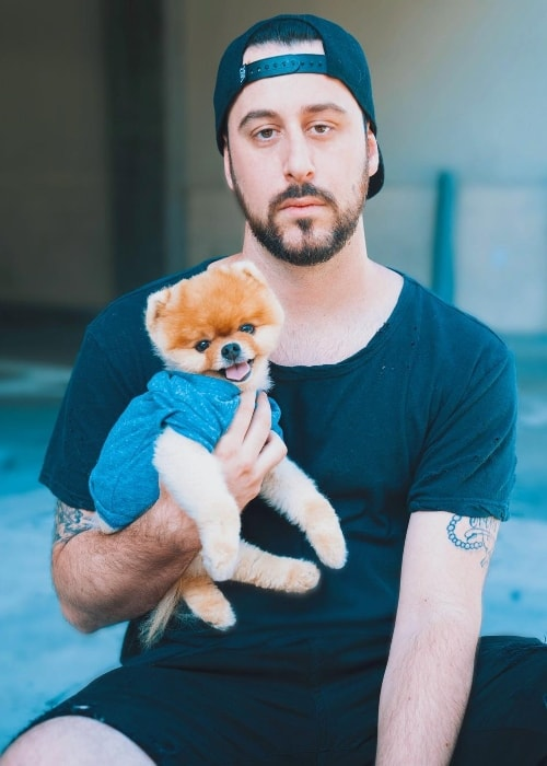 Jon Paul Piques posing with a dog in August 2017