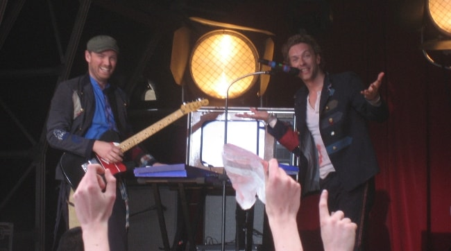Jonny Buckland (Left) with Chris Martin in June 2008