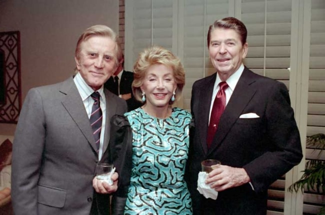 Kirk Douglas with wife Anne Buydens and former U.S. President Ronald Reagan (Right) at a private dinner at the Eldorado Country Club, California in December 1987