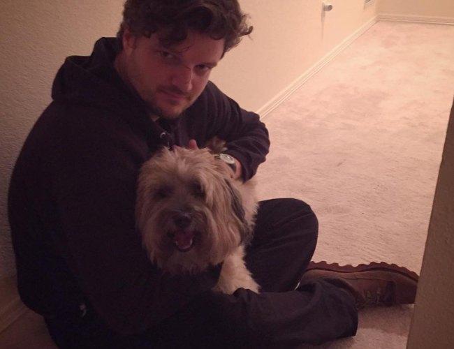 Matt Jones with his dog as seen in December 2015